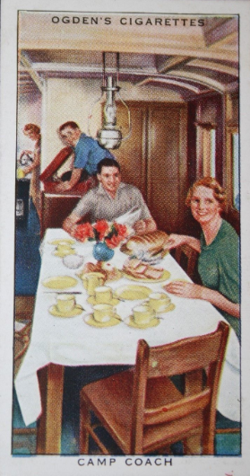 One of a series of cigarette cards issued by Ogden's Tobacco in the 1930s, showing a rather jolly, staged impression of the interior of a GWR Camp Coach.
