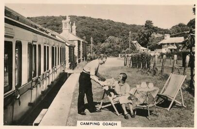 A 'Senior Service' cigarette card, again from the 1930s, showing campers outside a GWR Clerestory Camp Coach stabled in a platform bay. The original was probably a GWR publicity image and the coach probably a Brake Third.