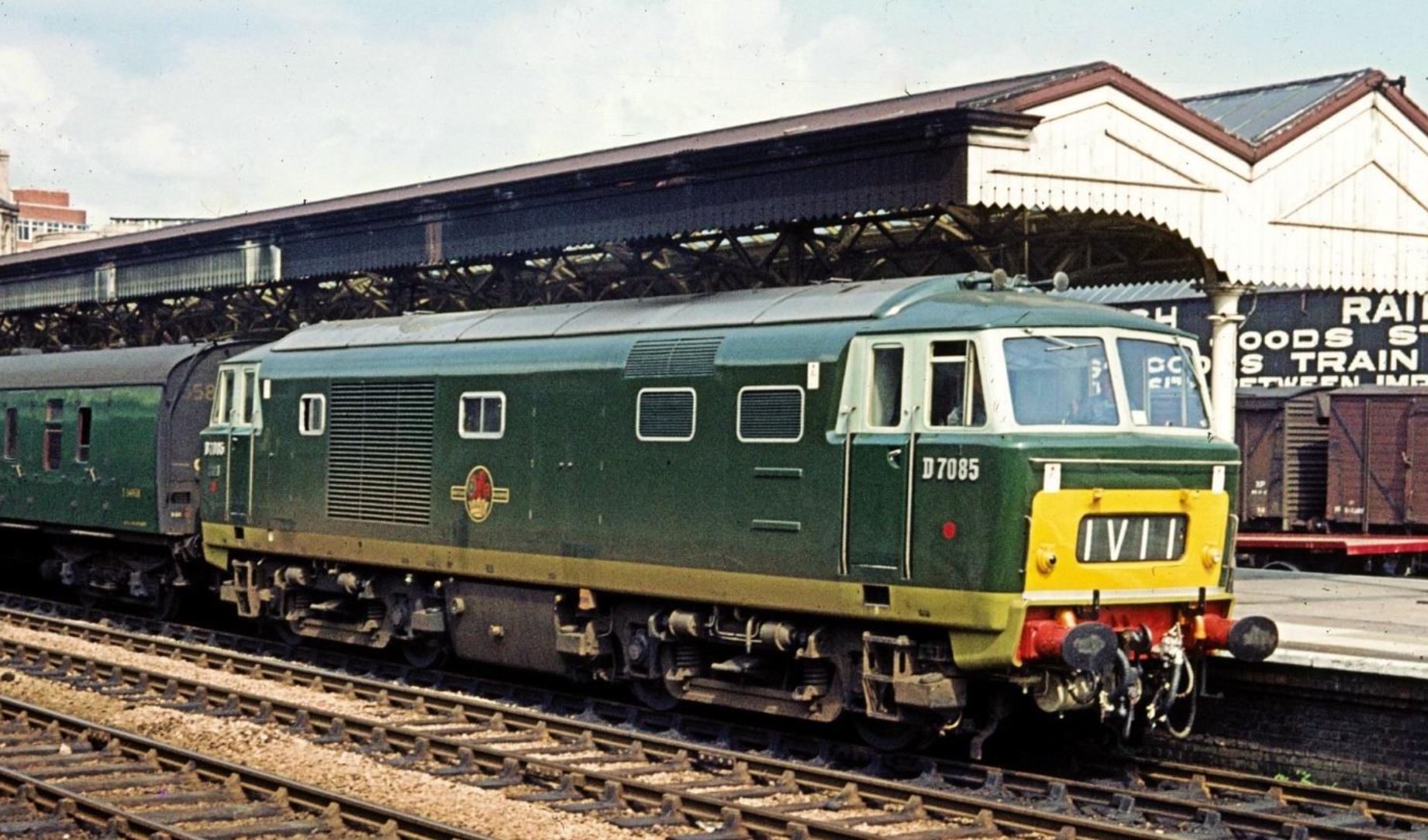 A stunning photograph taken in July 1963. Hymek D7085 is heading a rake of SR green-liveried Mk 1's on the mid-day SO Portsmouth & Brighton to Swansea, calling at Newport High Street at 16.15. A useful reference photo for weathering that pristine Heljan Hymek you have safely boxed away, too.  Photograph posted by kind permission of Christopher Gwilliam.