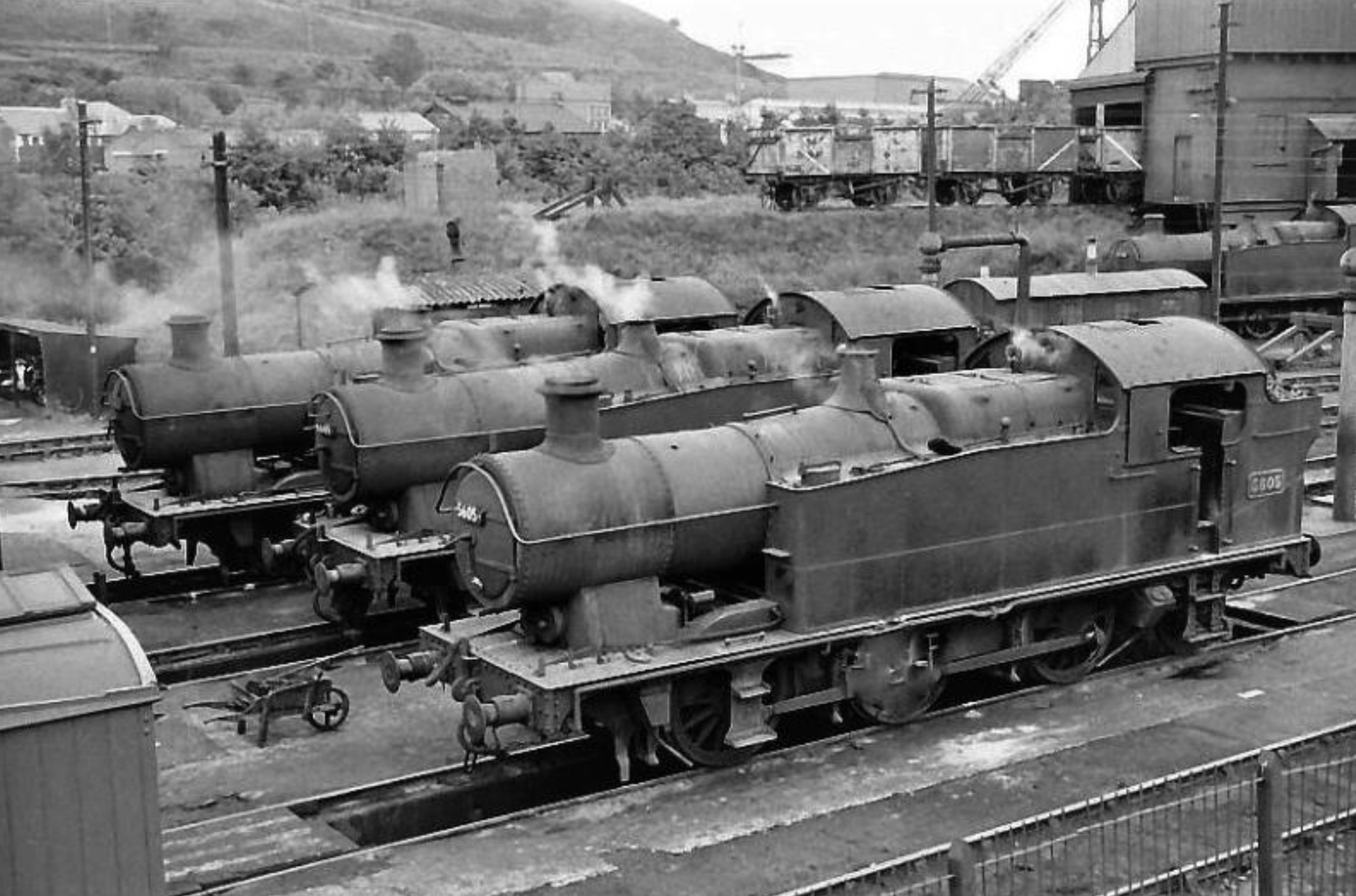 Classic Valleys tank engines, ex-GWR 56XX and 66XX 0-6-2 Classes nos. 5601, 6649 and 5605, on shed at Abercynon in the 1960s. Photograph used with thanks but source unknown [Facebook]