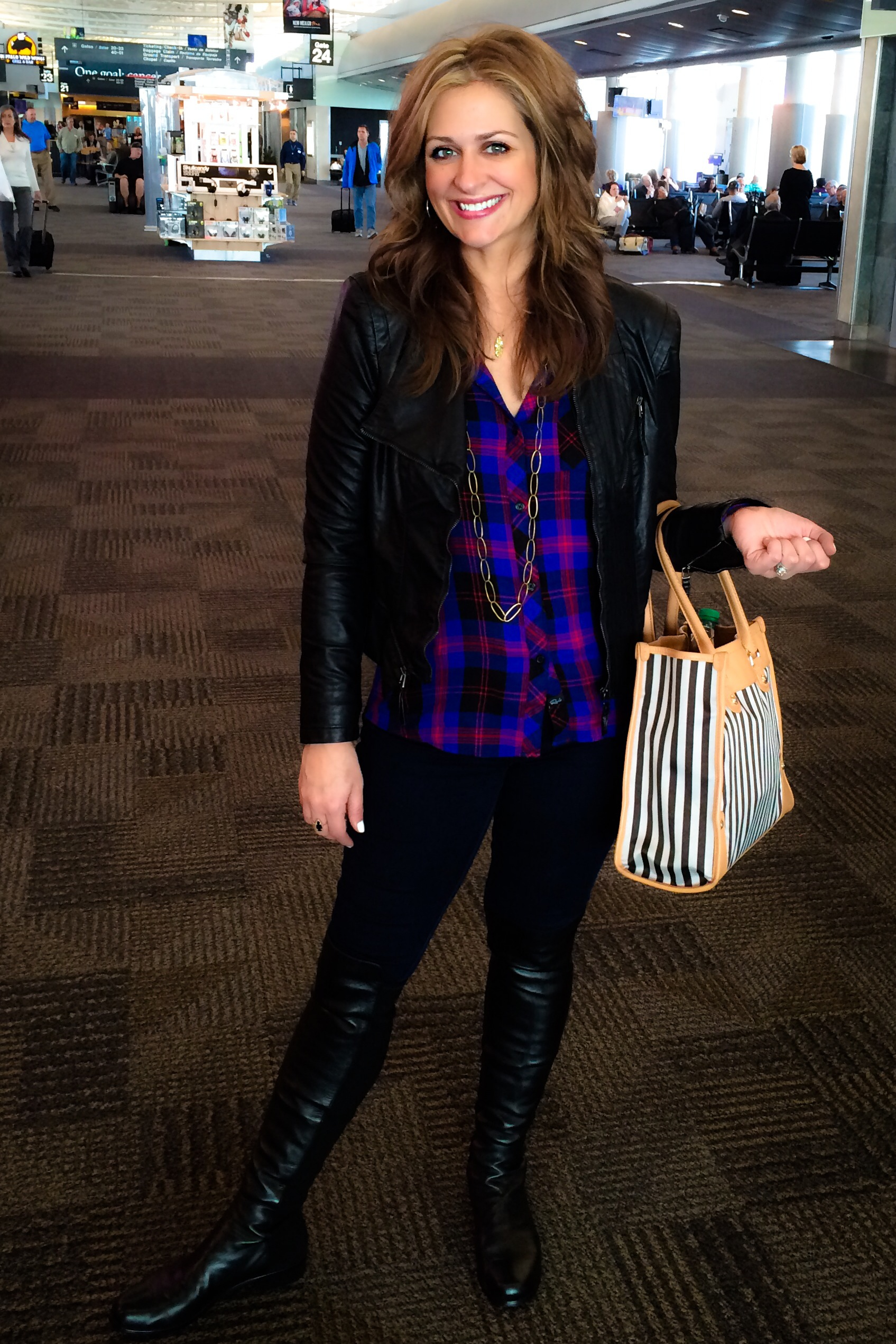 Traveling day. Leather jacket, tote bag, and comfortable yet cute boots. Love plaid for a punch of color.
