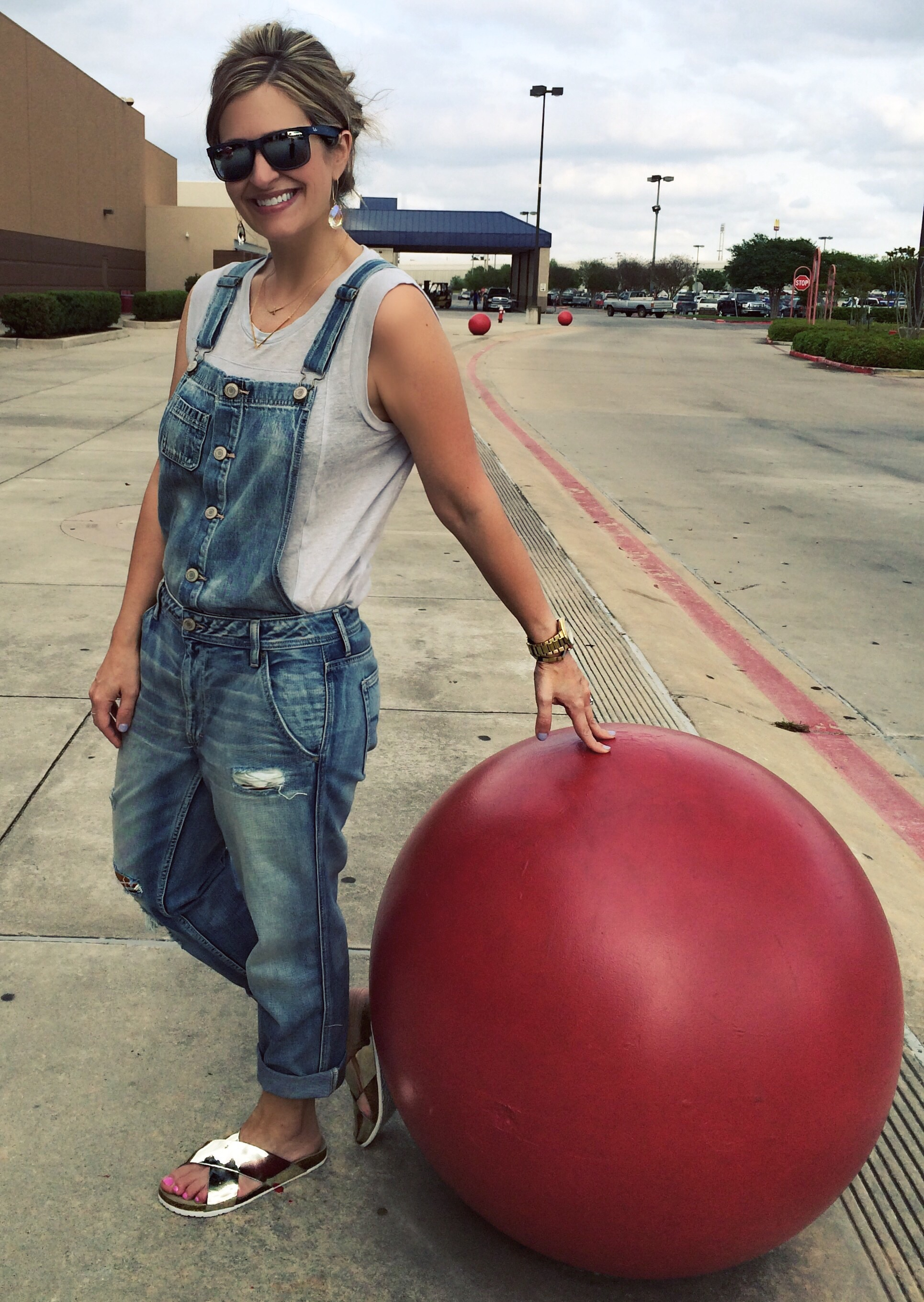 I can spot these red cement balls from any highway! Overalls:  American Eagle  Tee: Gap (last year similar  here ) Sandals:  Target  Earrings: Kendra Scott (sold out similar  here )