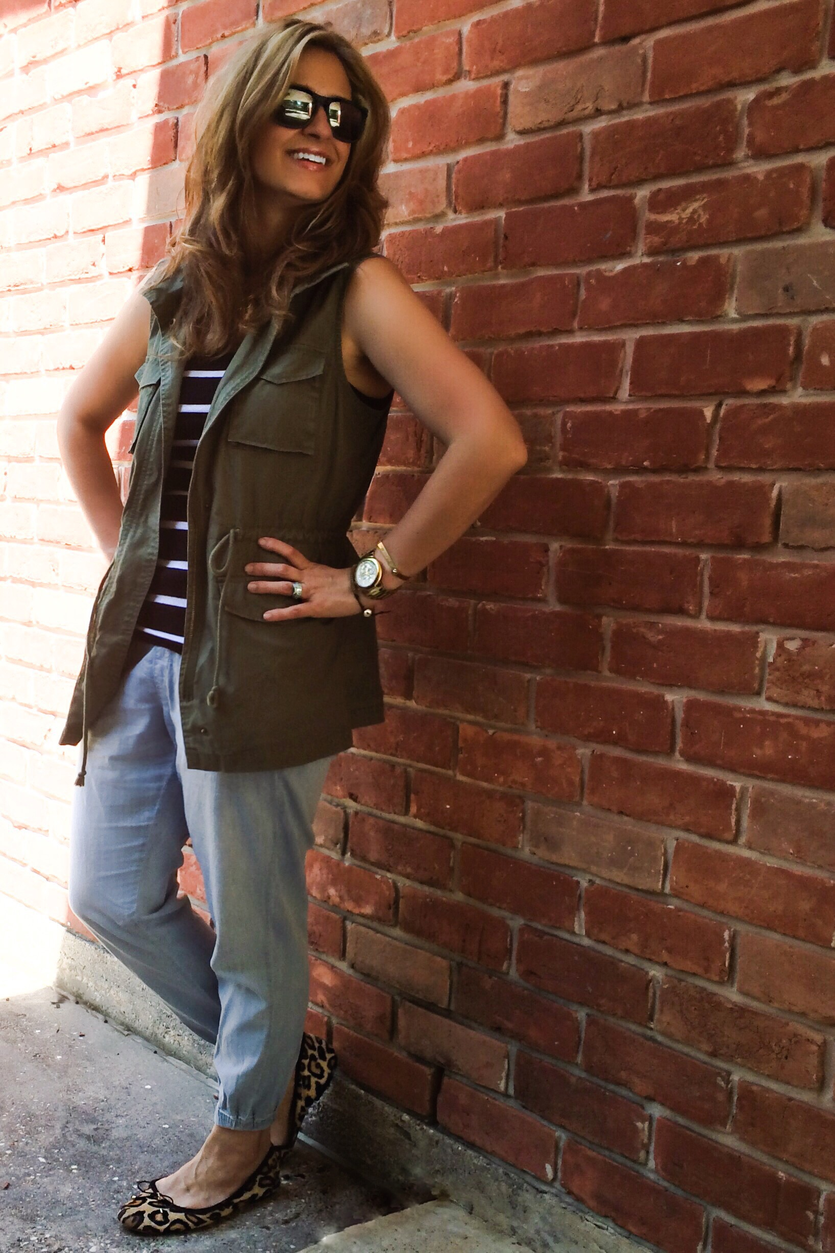 Sleeveless jacket: Old Navy (sold out but almost identical  here ) Tank:  Gap  Joggers:  Anthropologie  Shoes:  SamEdelman