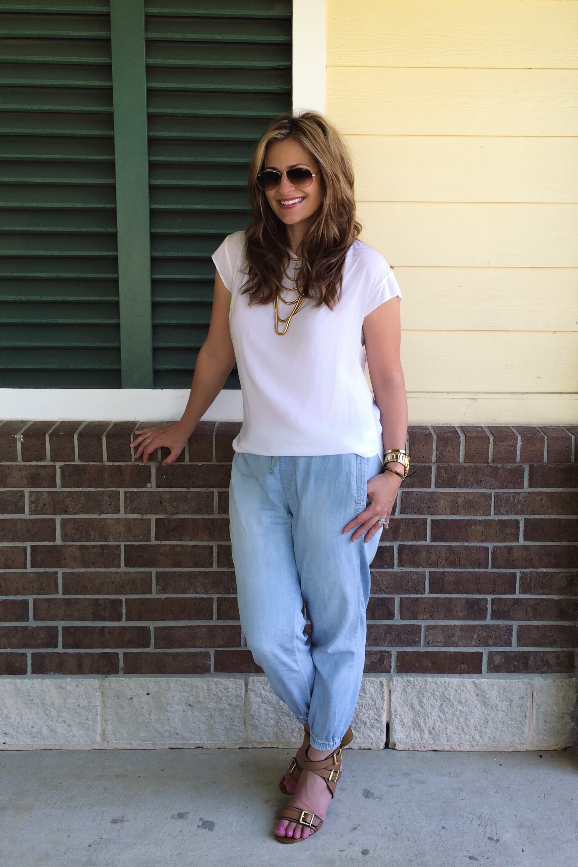 Blouse: Gap (old but similar and even cuter  here ) Joggers:  Anthropologie  Shoes:  Isola  Necklace:  Baublebar