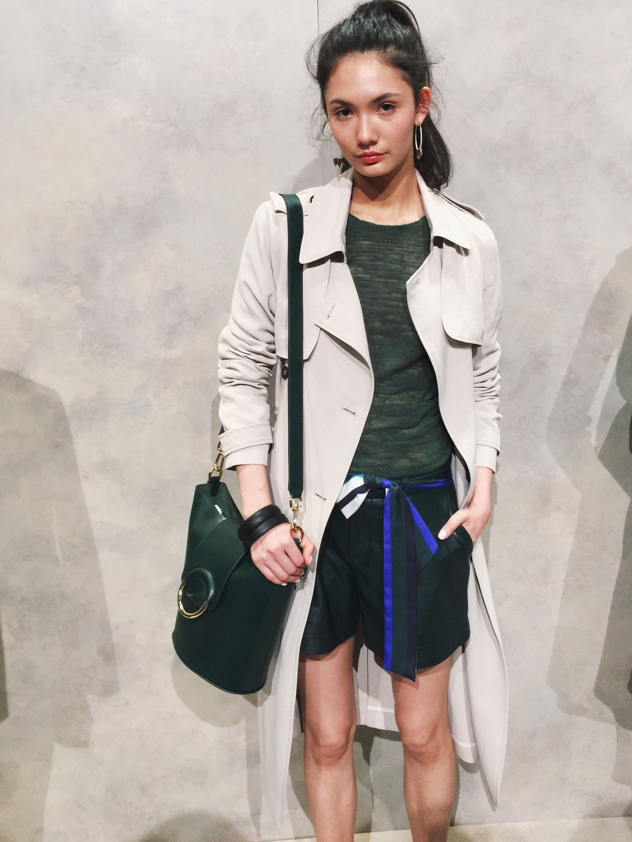 Again, forest green, but this time in faux leather shorts paired with a classic trench. A longer jacket, vest or cardigan over shorts or a dress is a current popular trend. It looked as though it's here to stay through Spring.