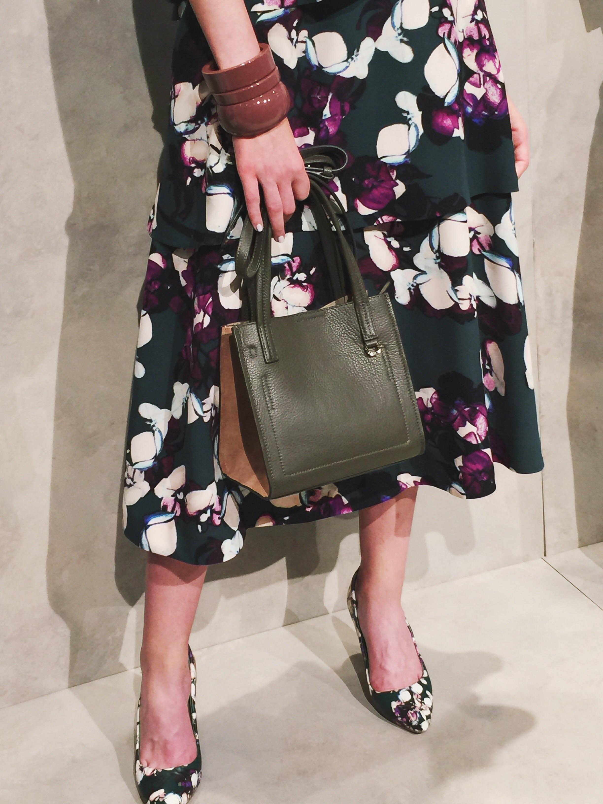 Big resin bangles and bold floral prints.