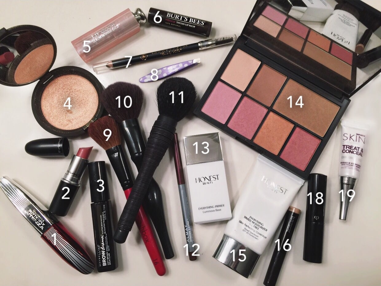 1.  L'Oreal Butterfly Intenza Mascara  2.  MAC Brave  3.  Maybelline Brow Drama  4.  Becca with Jaclyn Hill highlighter  5.  Dior Addict Lip Glow  6.  Burt's Bees Tinted Lip Balm  7.  Anastasia Brow Wiz  8.  Tweezerman  9.  Smashbox cheek brush  10.  Sonia Kashuk brush  11.  NARS brush  12.  Almay Eyeliner  13.  Honest Beauty Everything Primer  14. NARS by Steven Klein palette (included are  Laguna bronzer  and several  blush  shades) The palette is no longer available. 15.  Honest Beauty Everything Tinted Moisturizer Oil Free  16.  Laura Mercier Caviar Eyeshadow  18.  Cle Du Peau concealer  19.  Miracle Skin Treat & Clear concealer