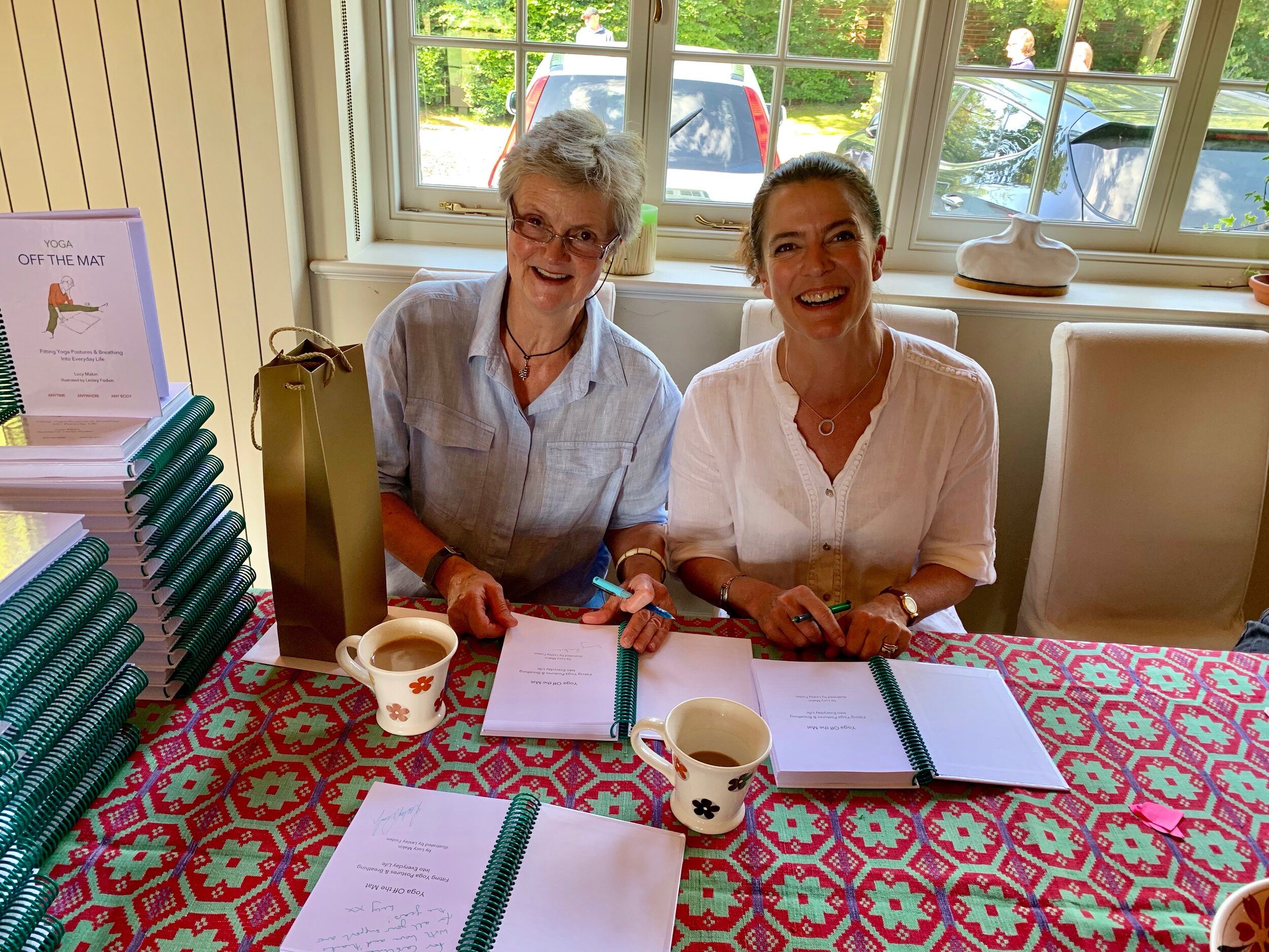 Lucy and me signing books on 22 June 2019