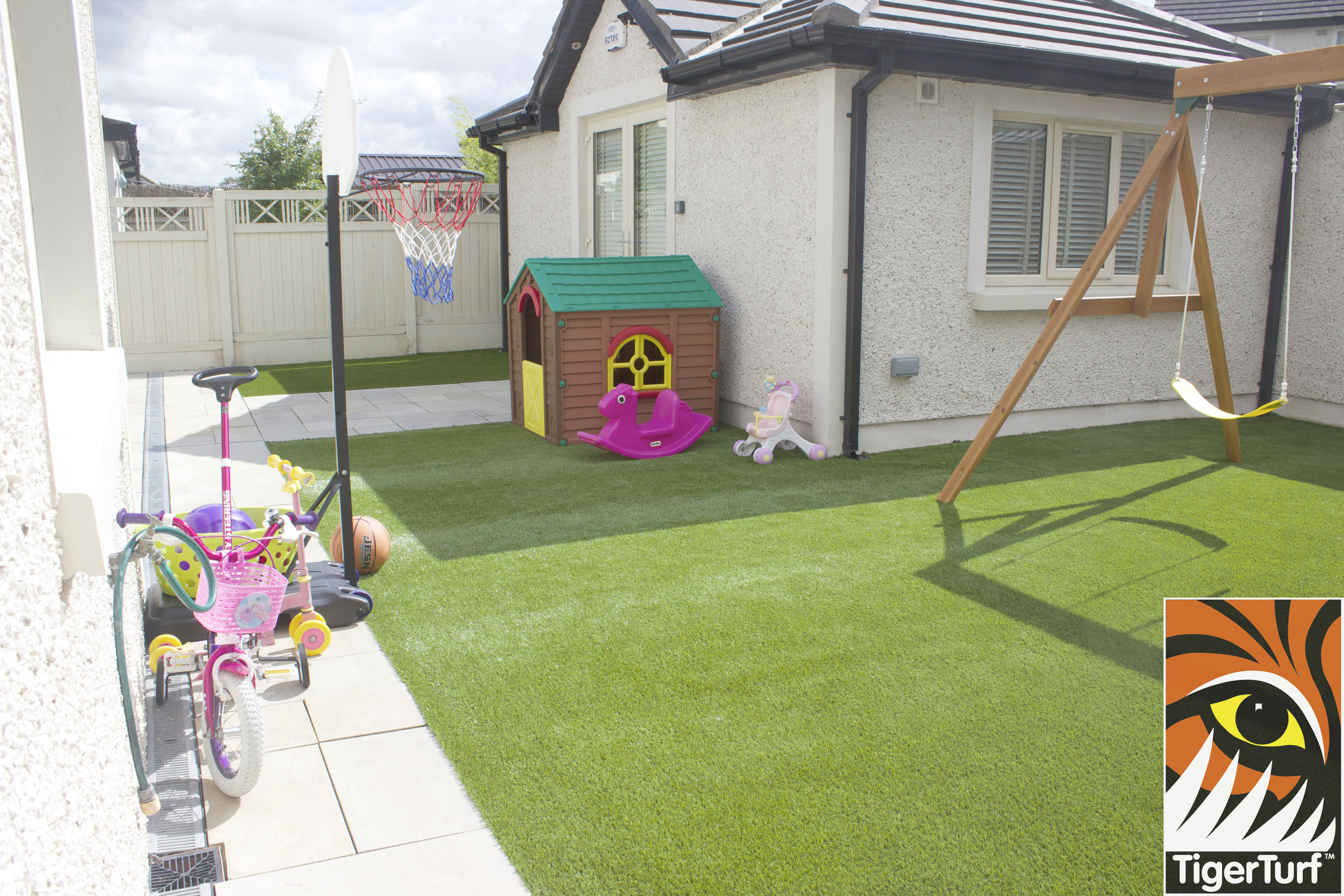 Family garden with green lawn
