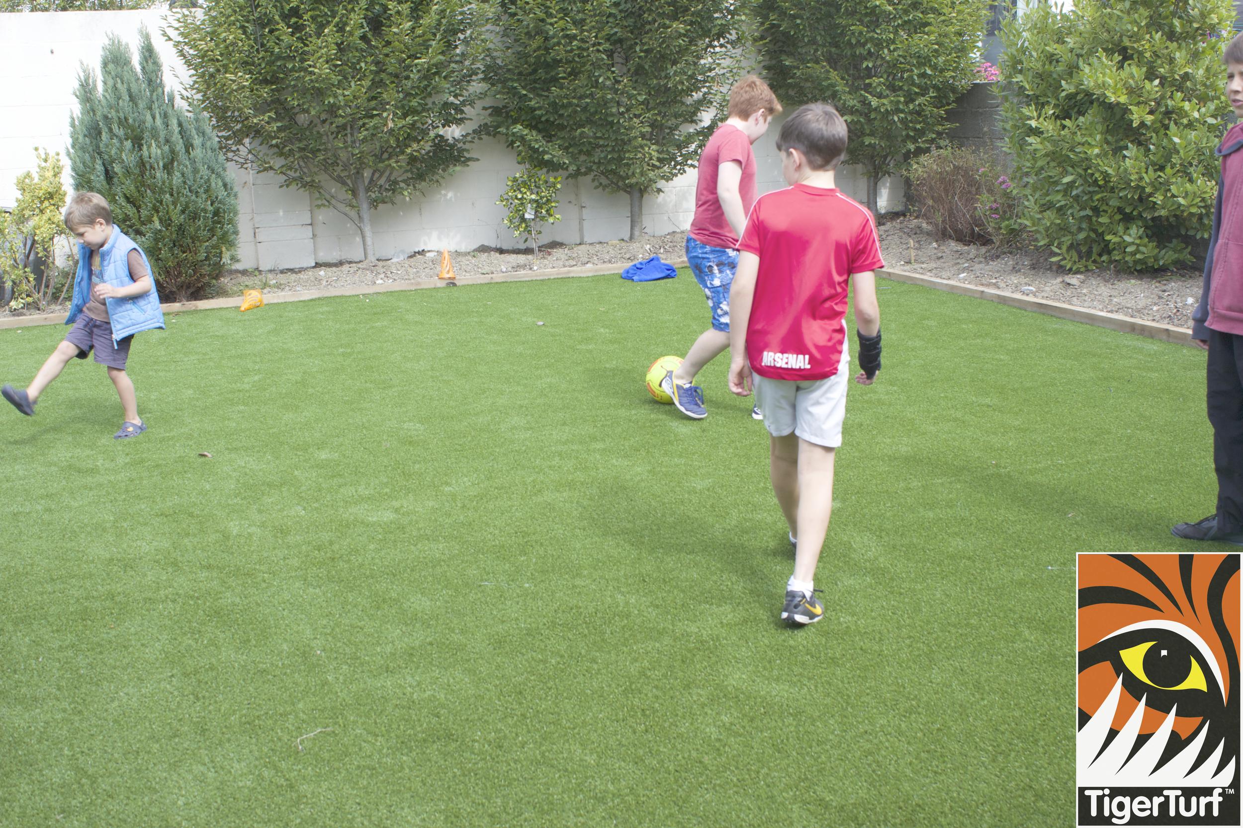 kids playing football on TigerTurf