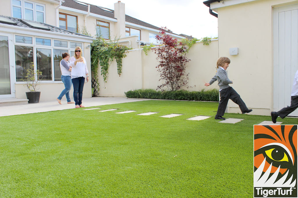 kids playing on garden lawn