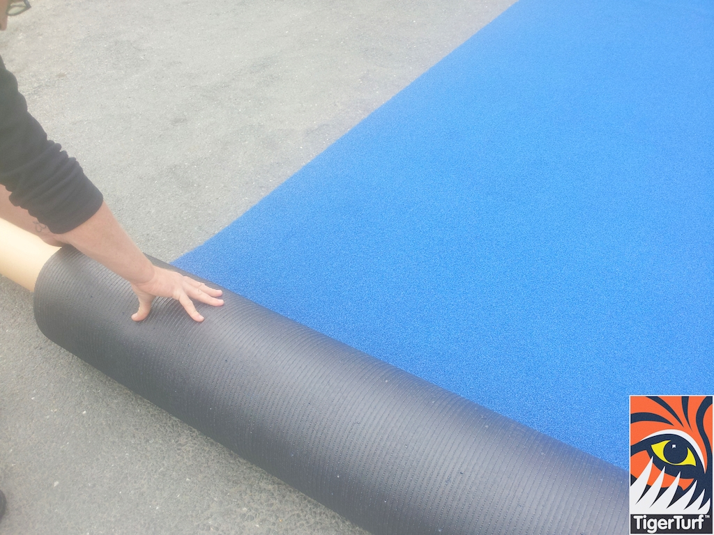 Approved Installers rolling TigerTurf