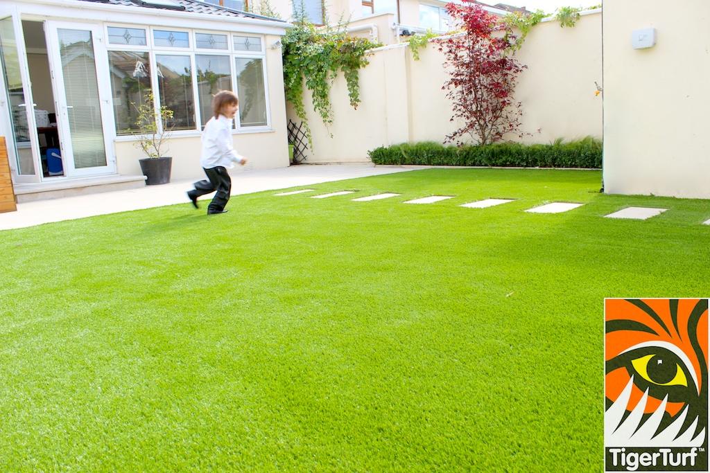 boy running on grass
