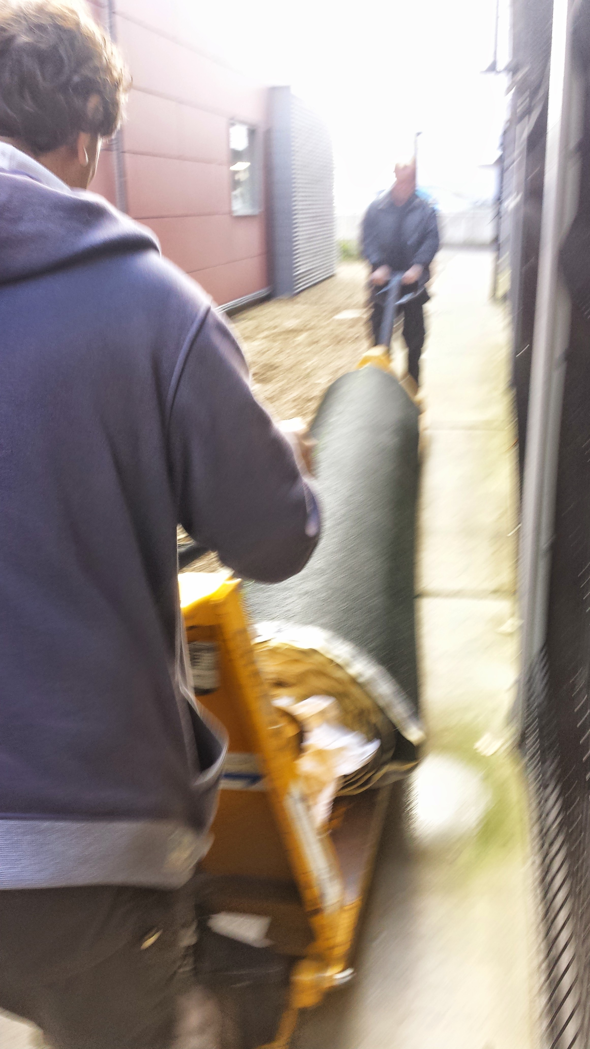transporting rolls of TigerTurf synthetic Lawns