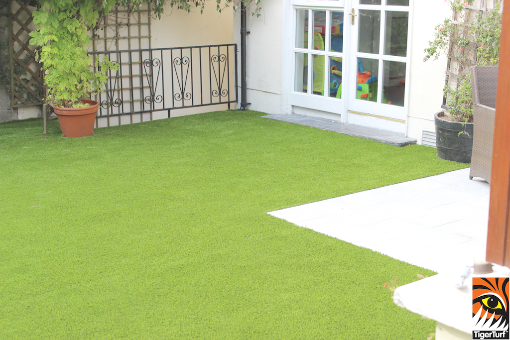 Natural stone paving and synthetic grass