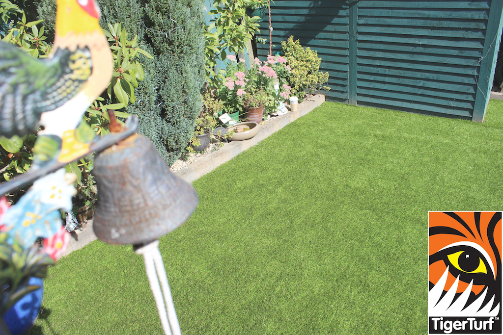 bell and artificial grass