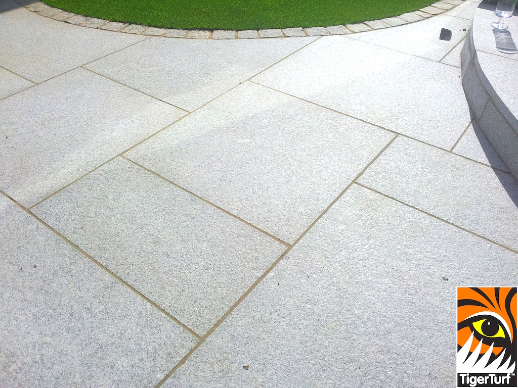 Granite paving and synthetic grass