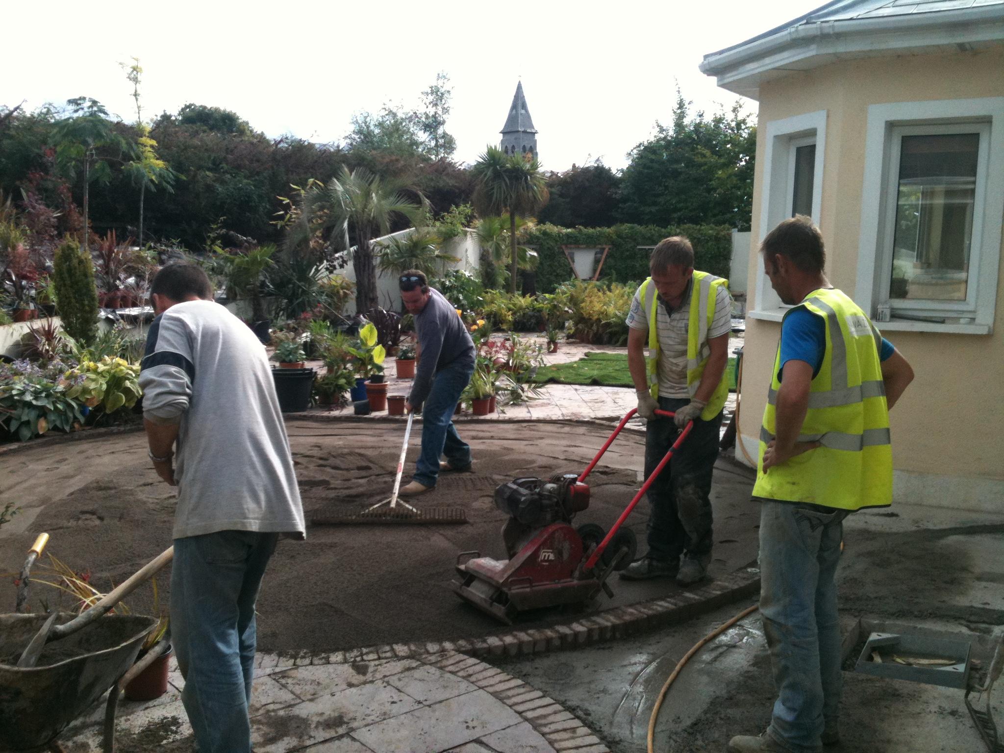 installation crew preparing ground for TigerTurf