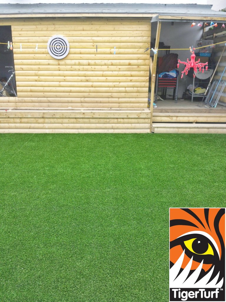 new synthetic lawn installed in back garden