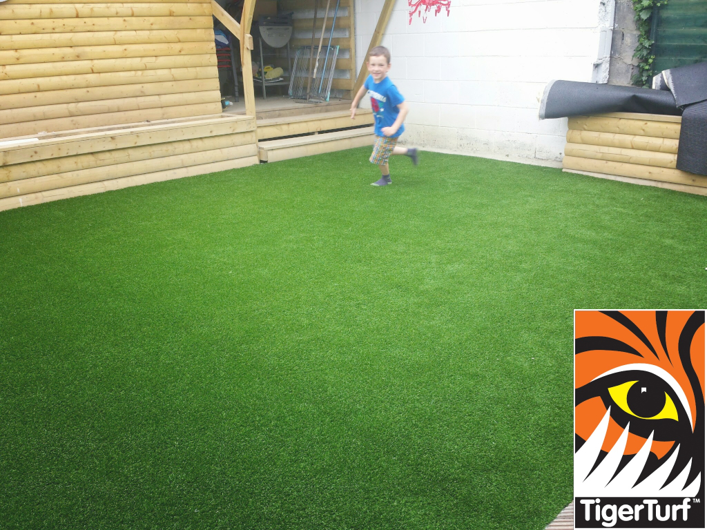 kid running on synthetic grass