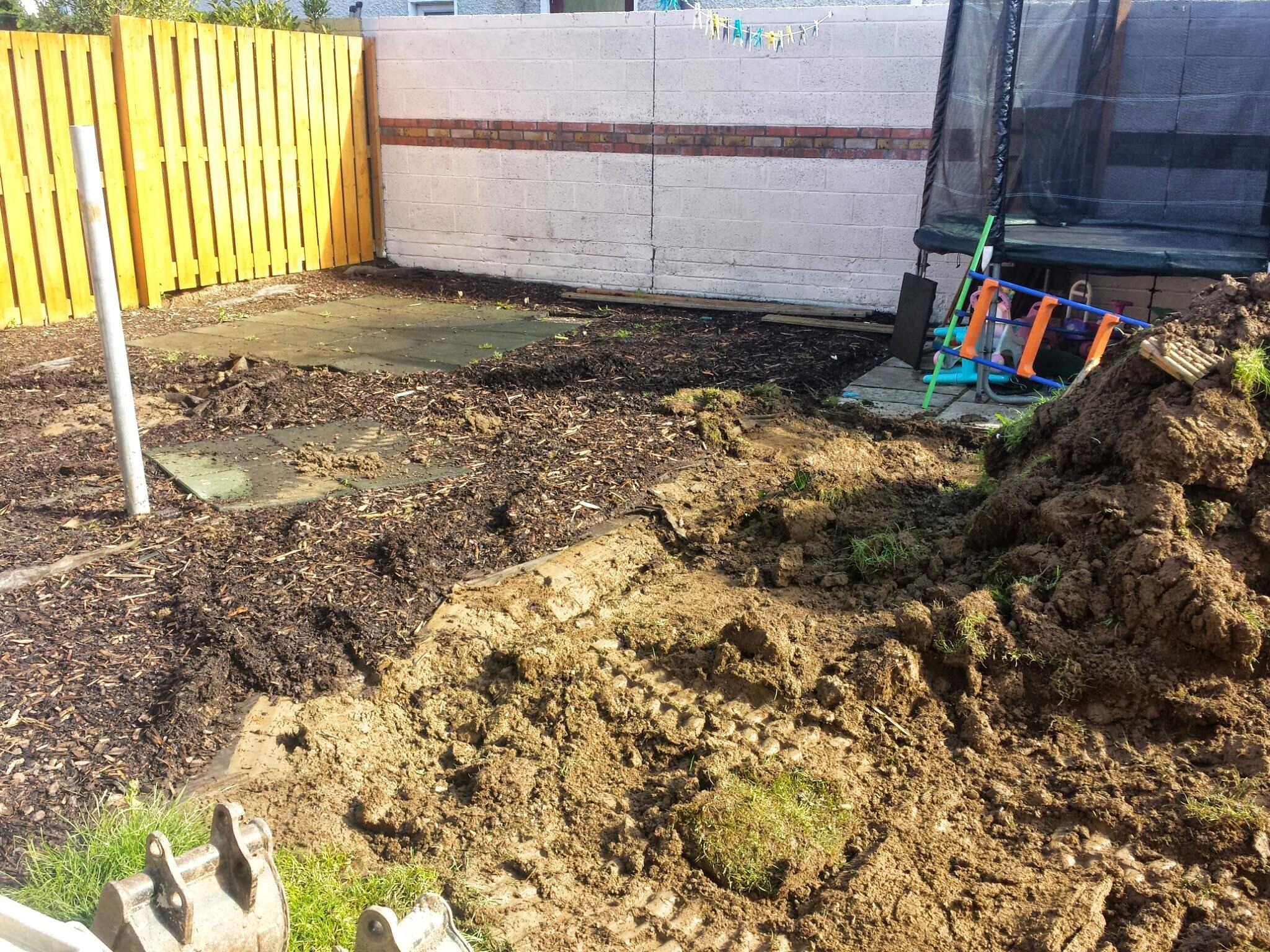 digger digging out topsoil