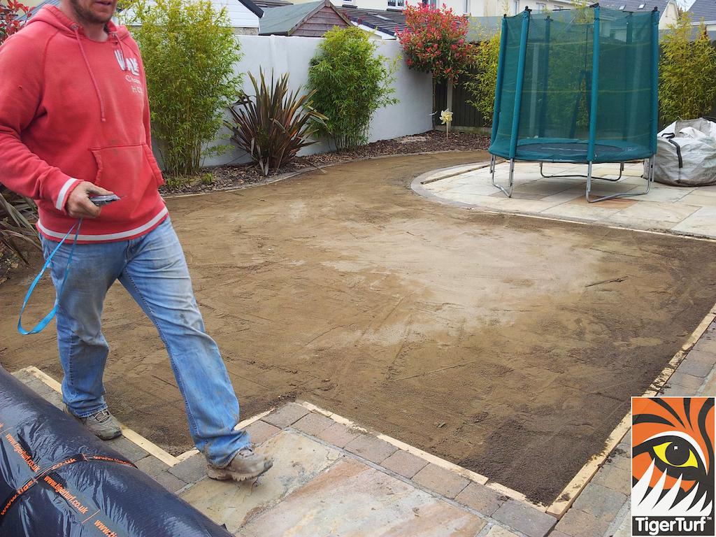 Installer preparing for grass installation