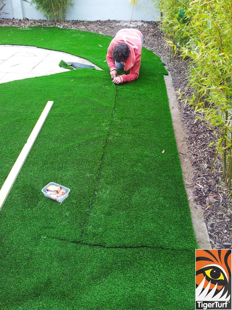 Installer trimming grass around patio