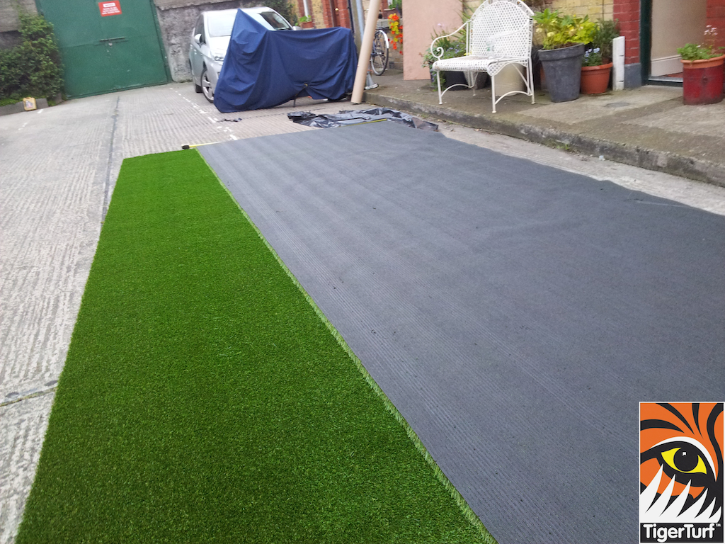 installers cutting grass