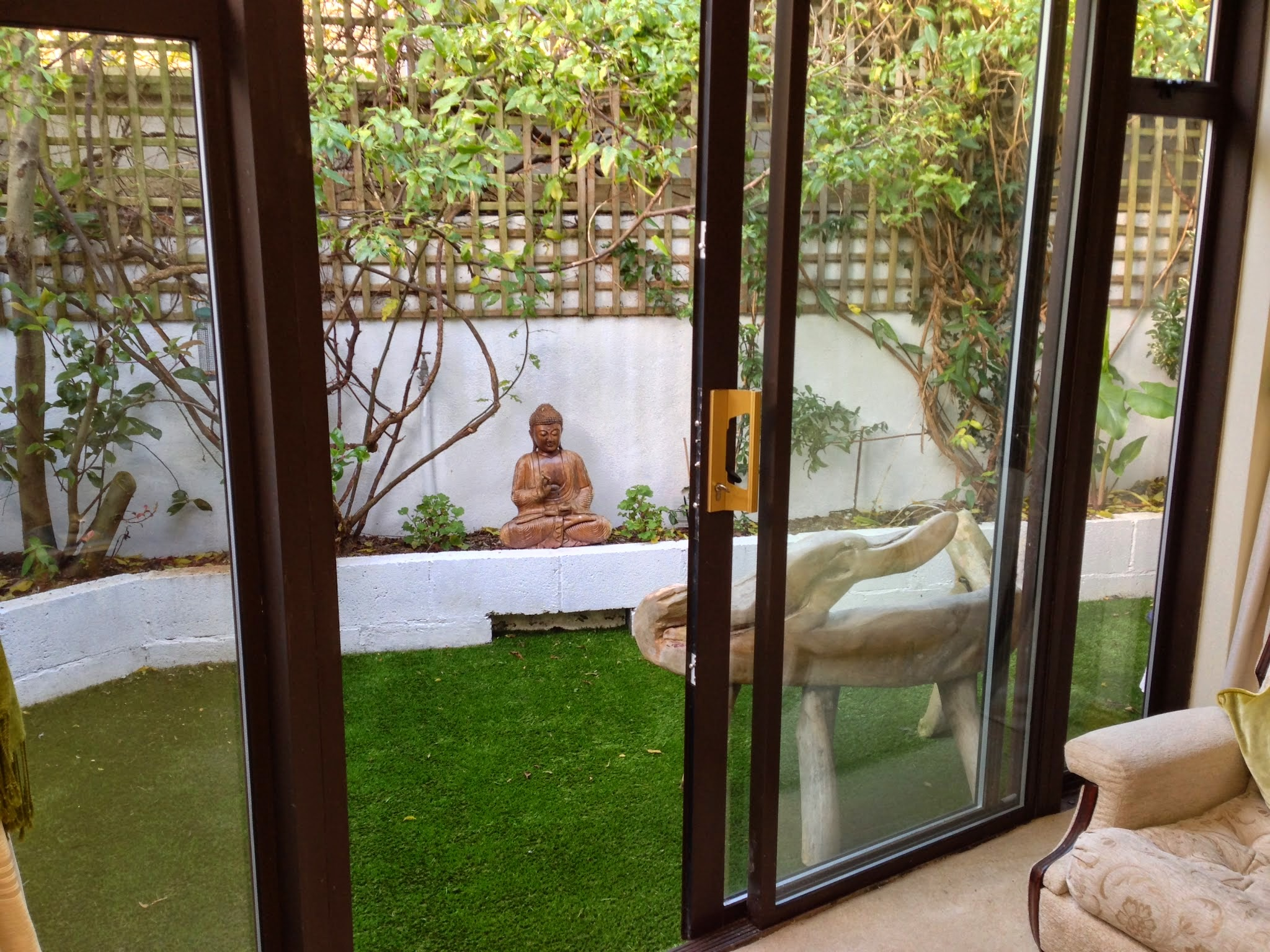 zen garden courtyard with synthetic turf
