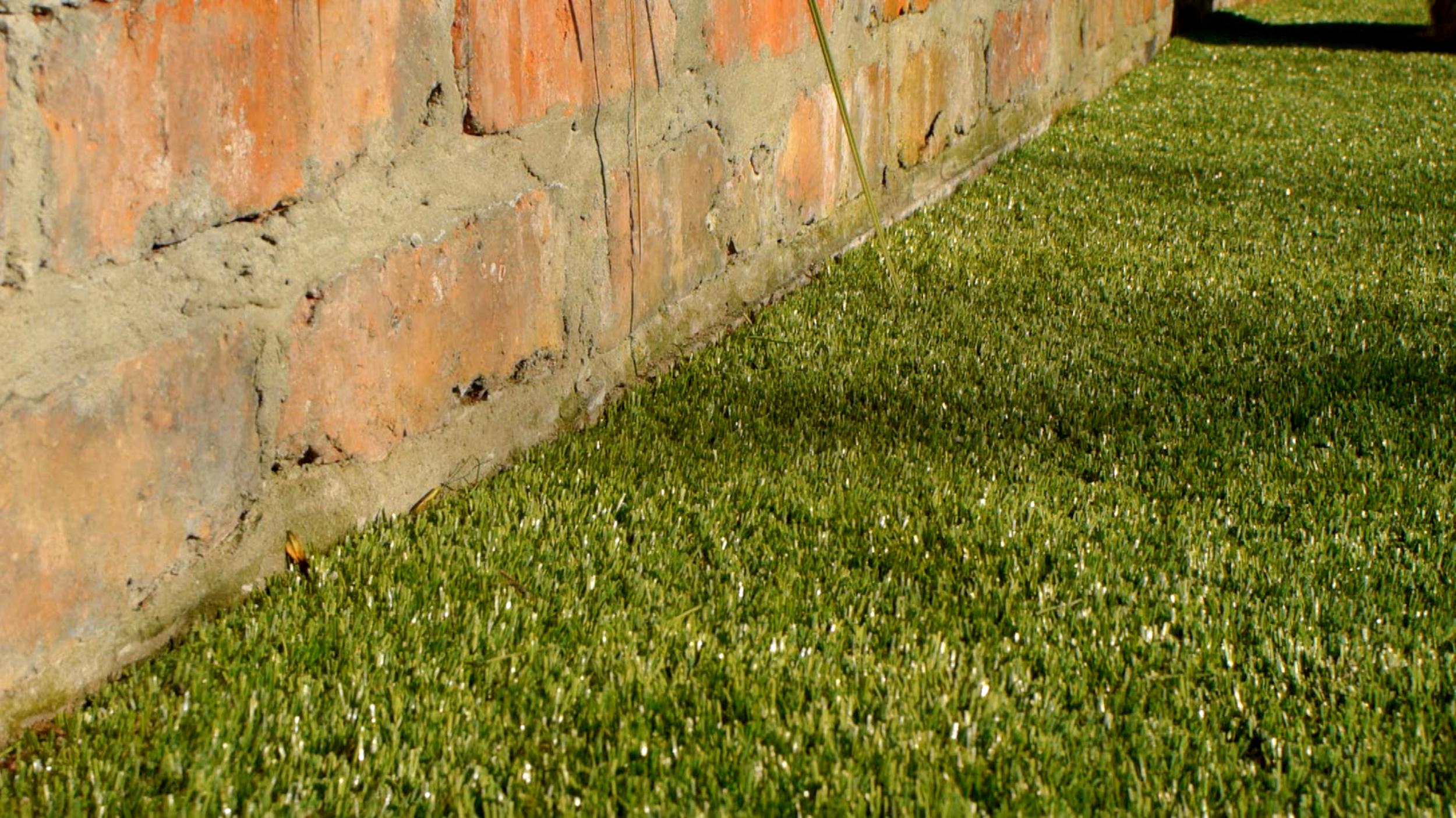 red brick wall and turf