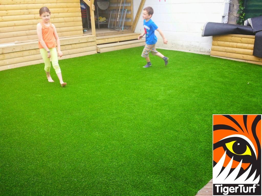 kids playing on turf