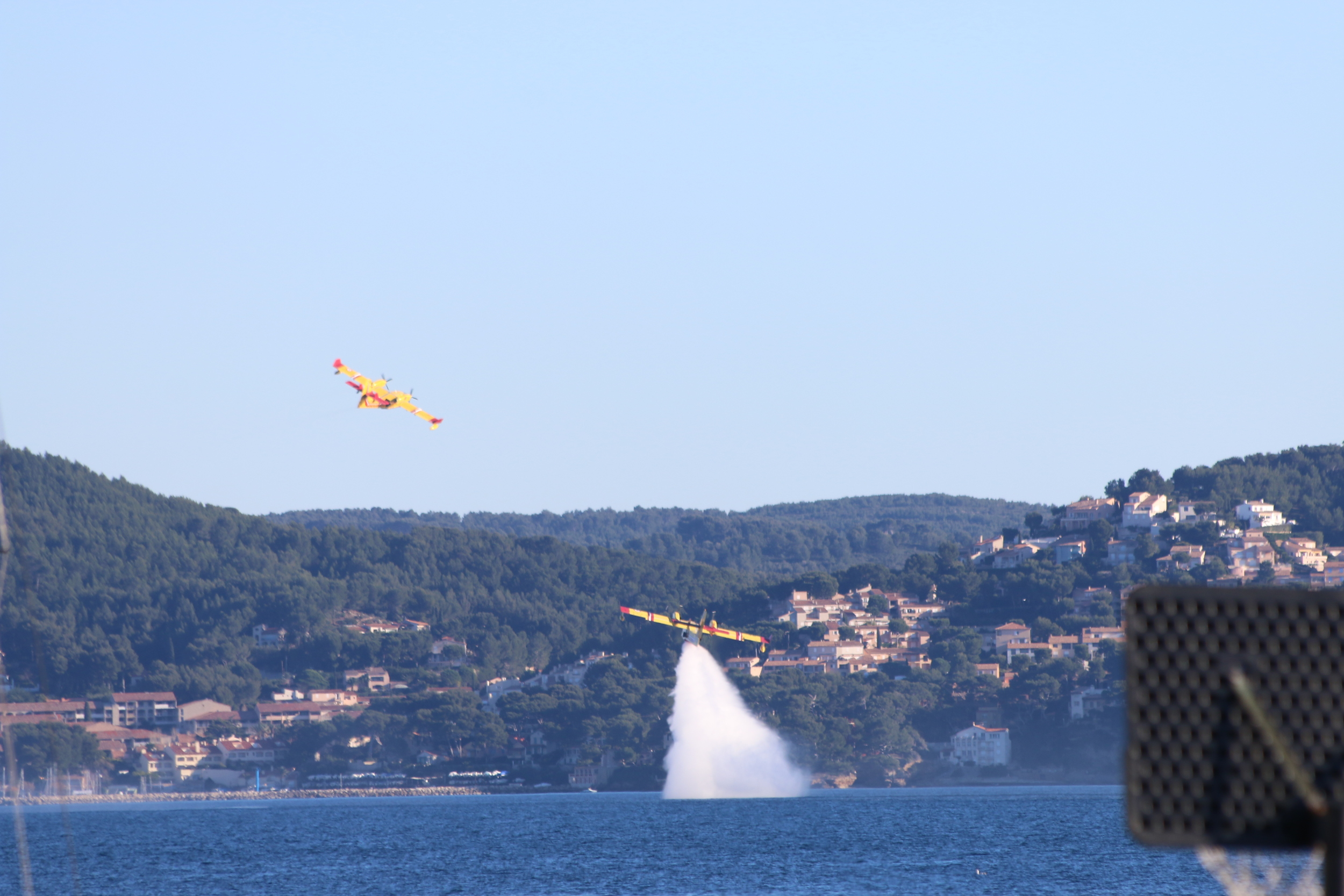 La Ciotat: fire fighting planes practicing filling and emptying water tanks.