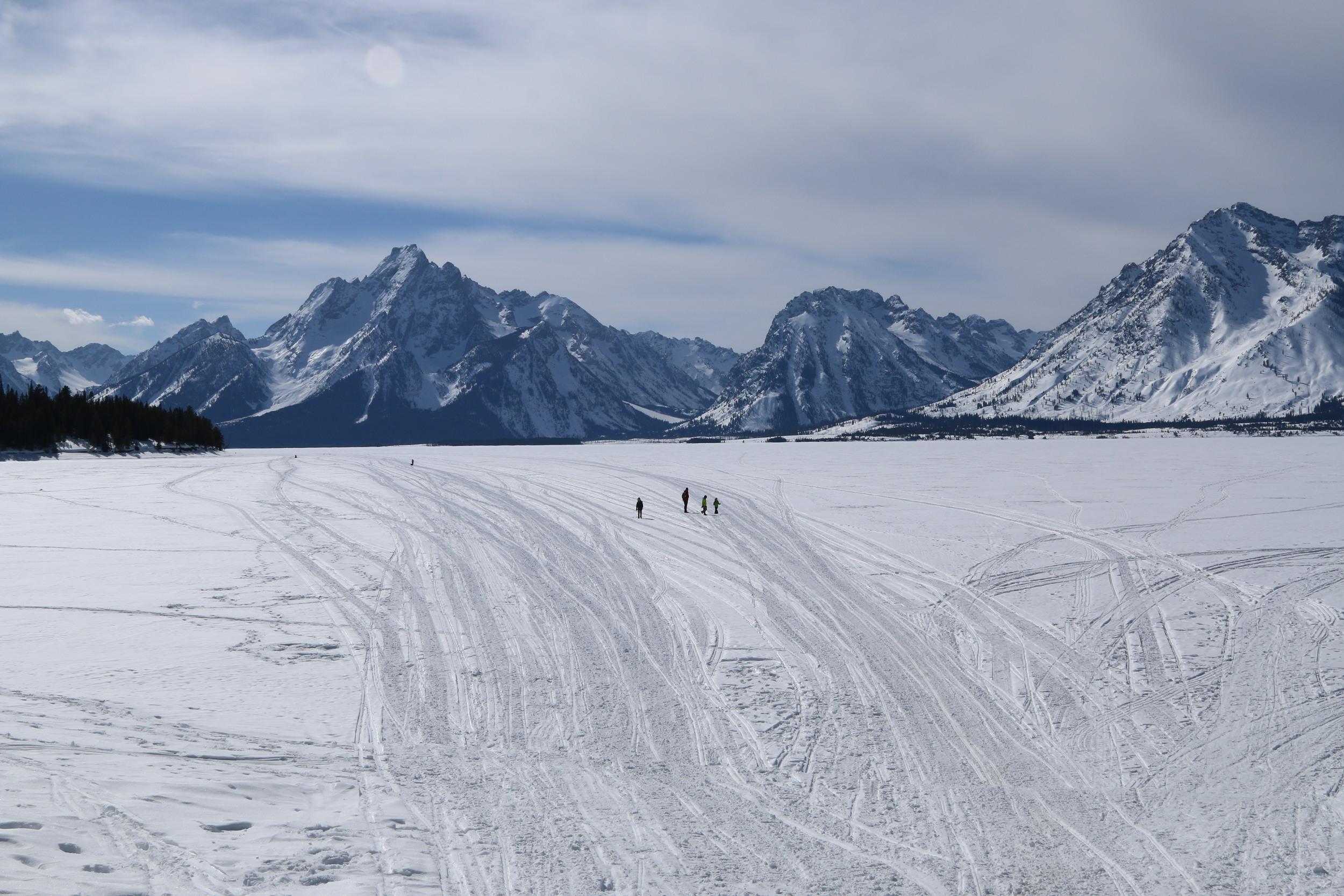 The Davies family walking out onto the frozen Jackson Lake