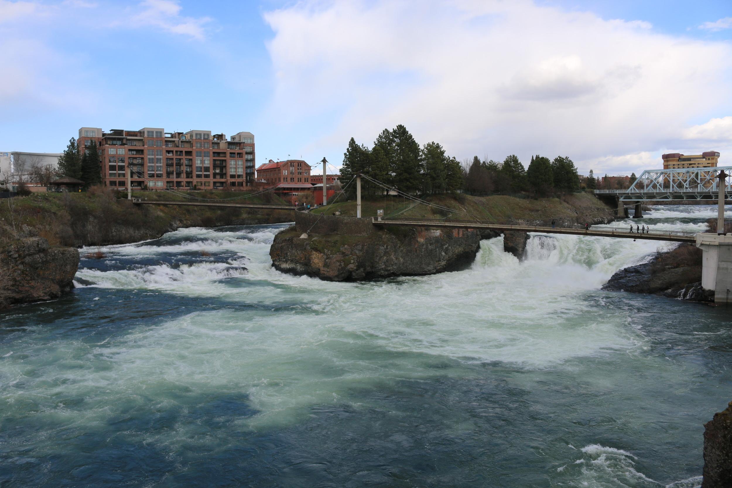 Spokane Falls flowing by Canada Island