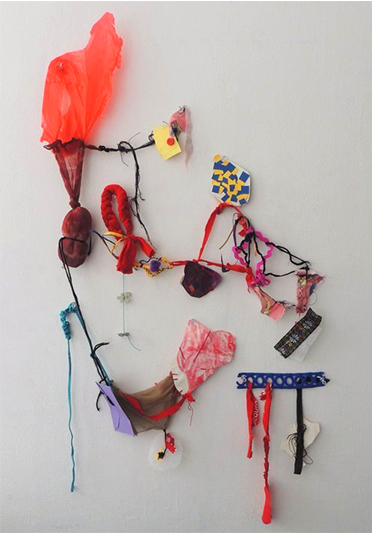 Debinha, 2016 - Paper, fabric, acrylic paint, glitter, crayon pieces, yarn, plastic bag, tights and pins.