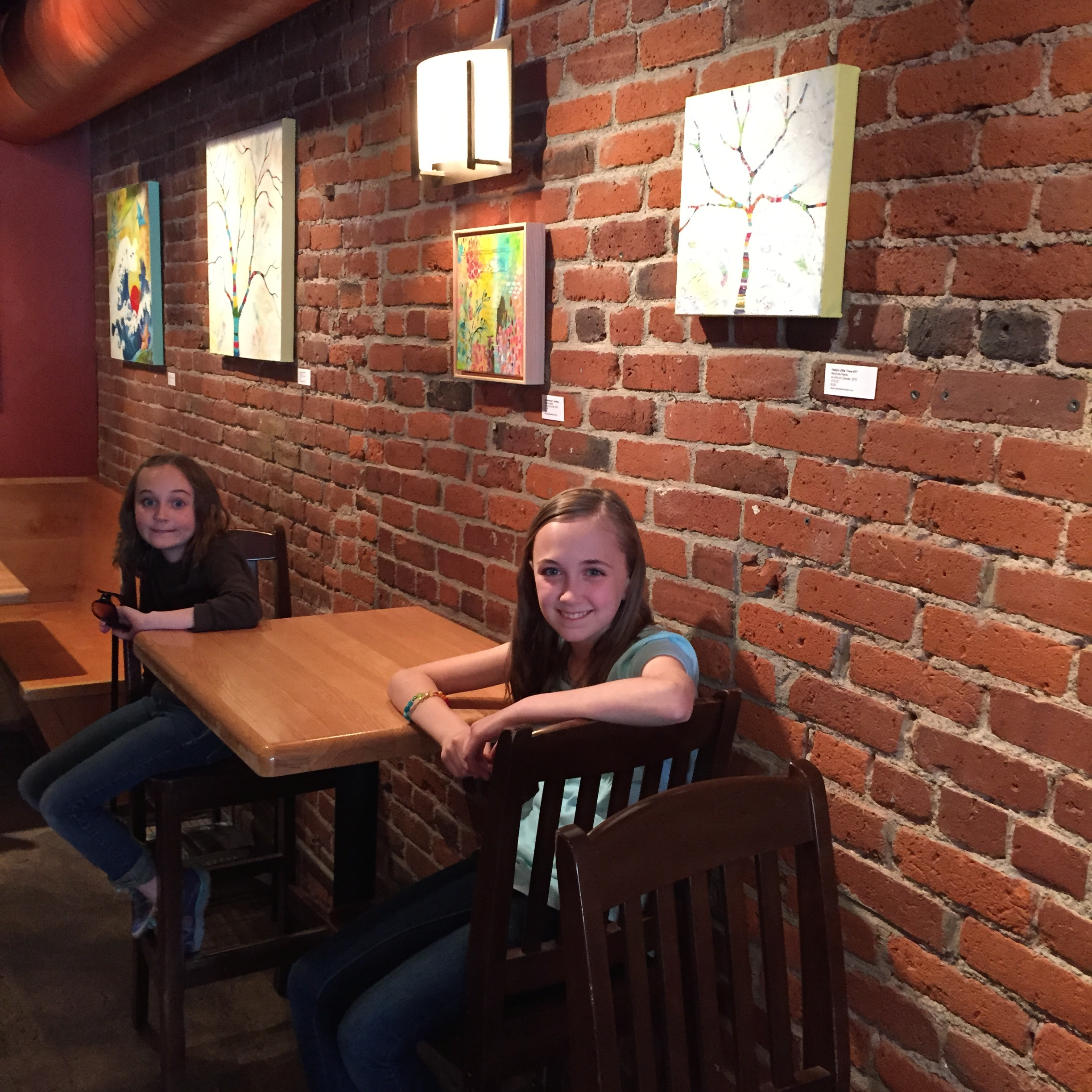 My adorable assistants taking a break from hanging the show at THUMP coffee.