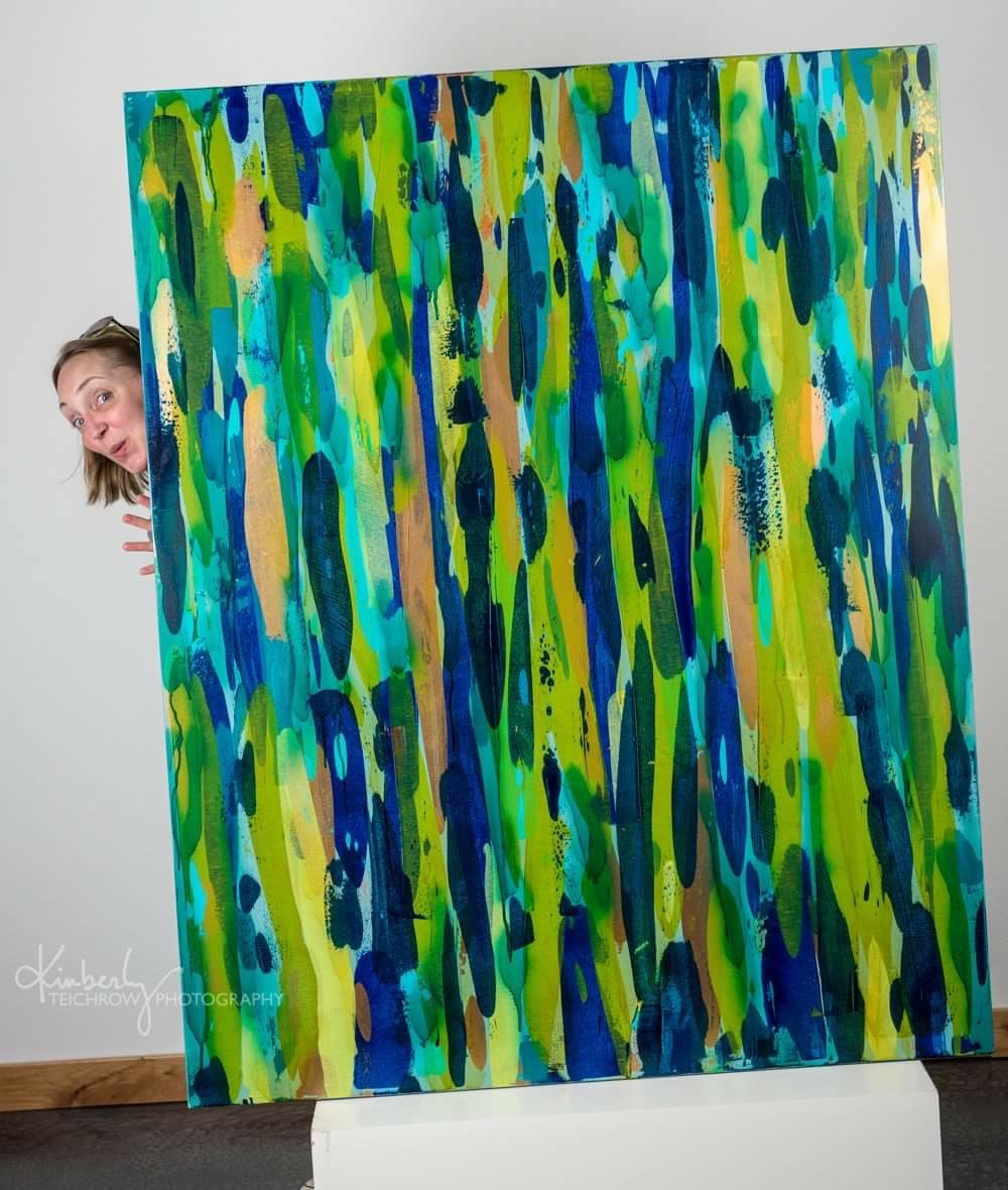 "Here's a fun peek-a-boo taken by my dear friend and very talented local photographer, Kimberly Teichrow of me with my ""Alive Again"" painting to give you a sense of scale."