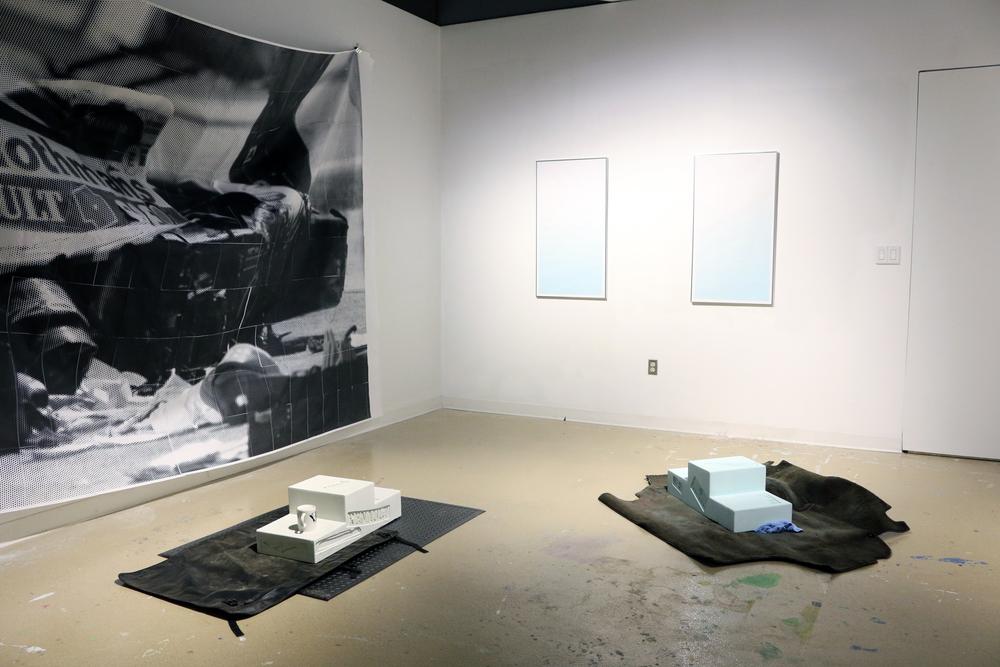 LIMINAL VALUE  , 2016  Inkjet prints, concrete, car debris, microfiber cloth, souvenir mug, pressure relief mat