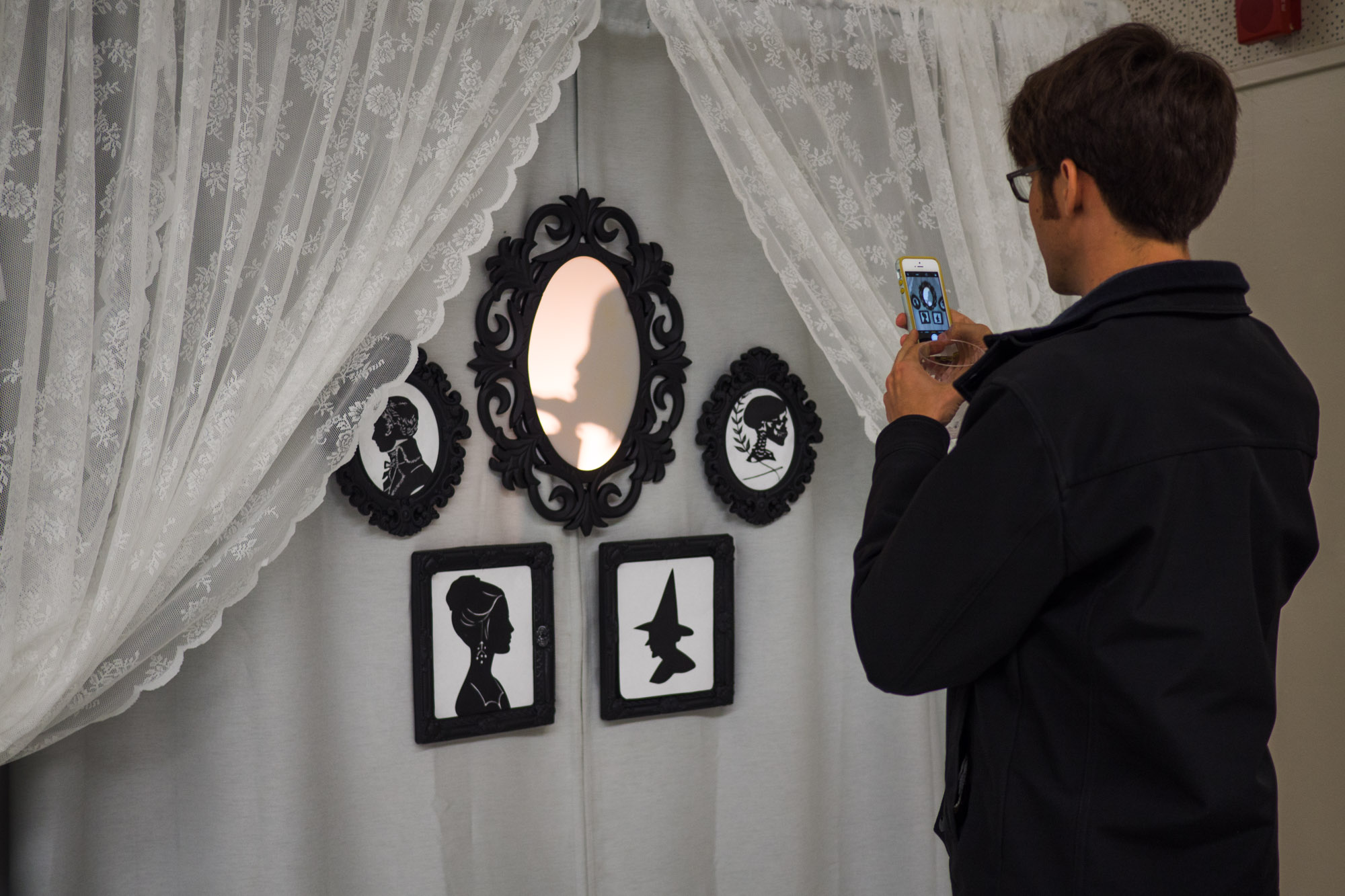 Guests step inside the booth and into the shadows to create a silhouette profile picture.