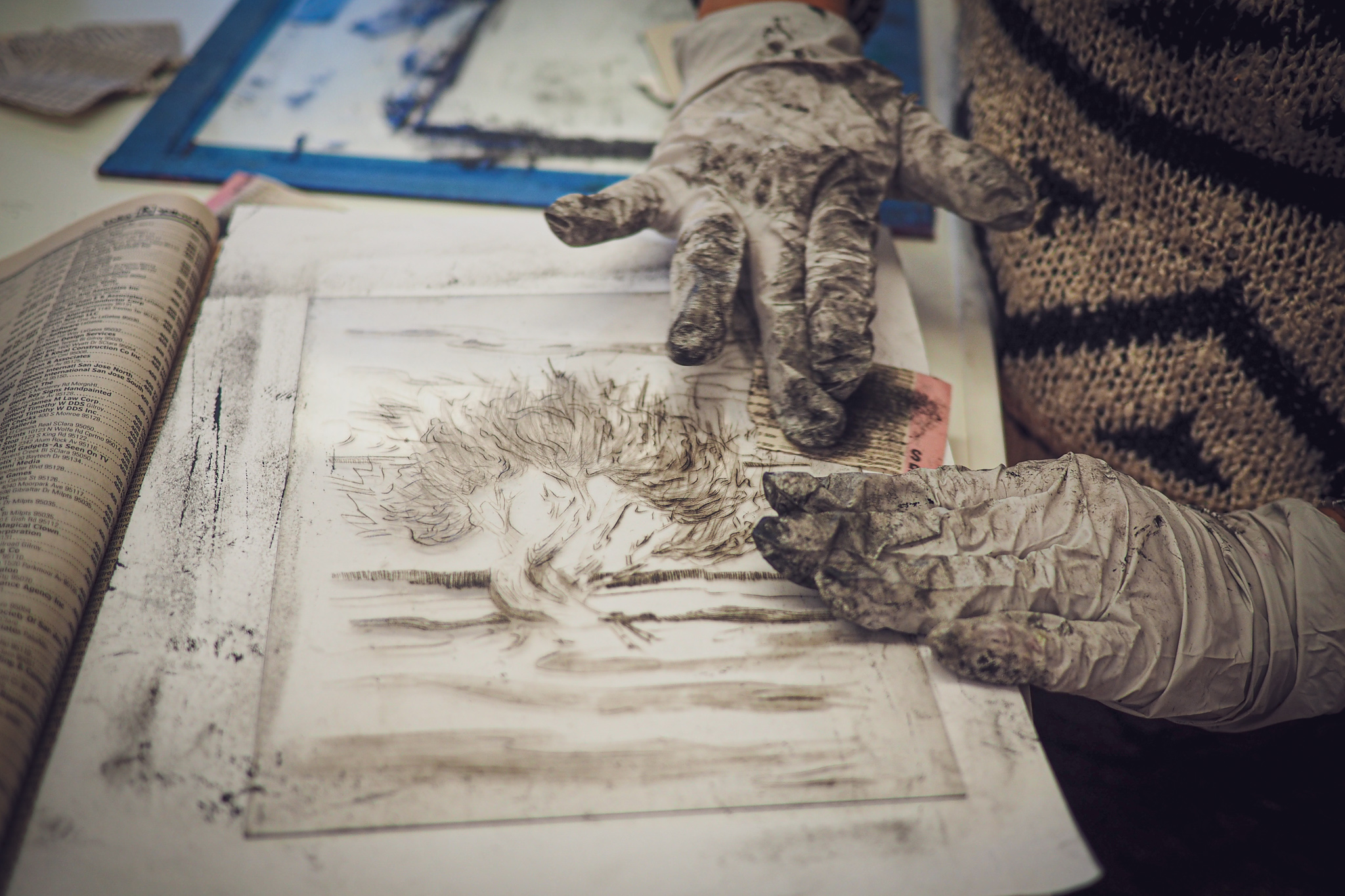Artist Rachel Stiff wiping a drypoint plate for printing