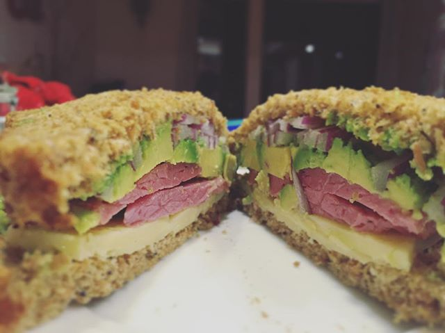 California St. P'trick Sandwich. From the bottom: Sprouted rye bread (toasted outside, soft inside), aged irish cheddar, corned beef, avocado, red onions. Totally hit the spot. Twice. 🍀