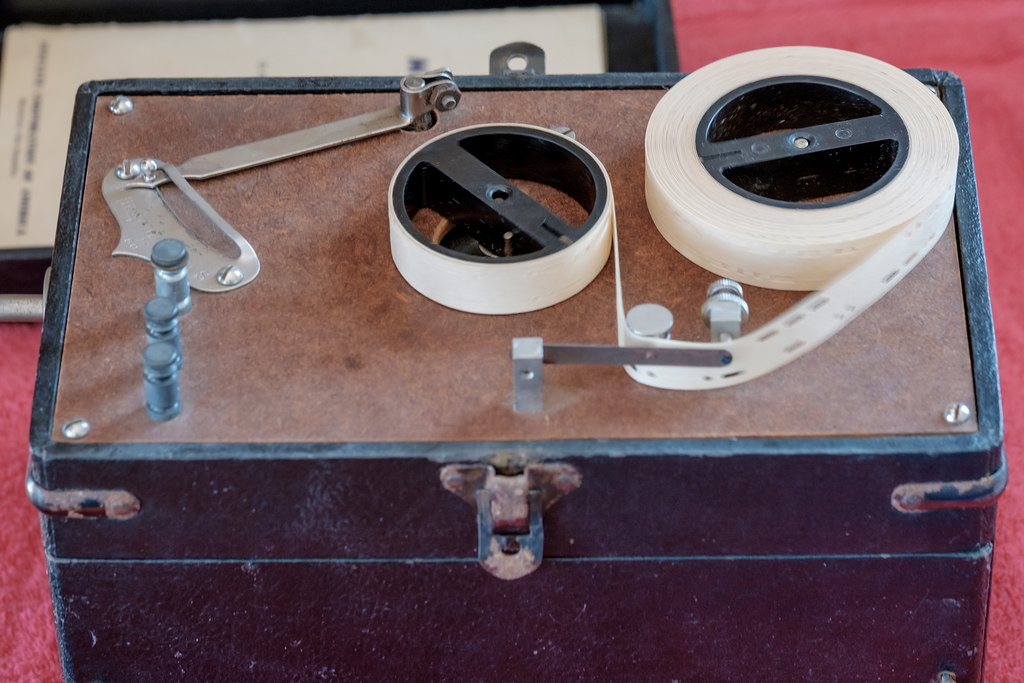 This device uses a punch tape to transit sounds. It was used for training.