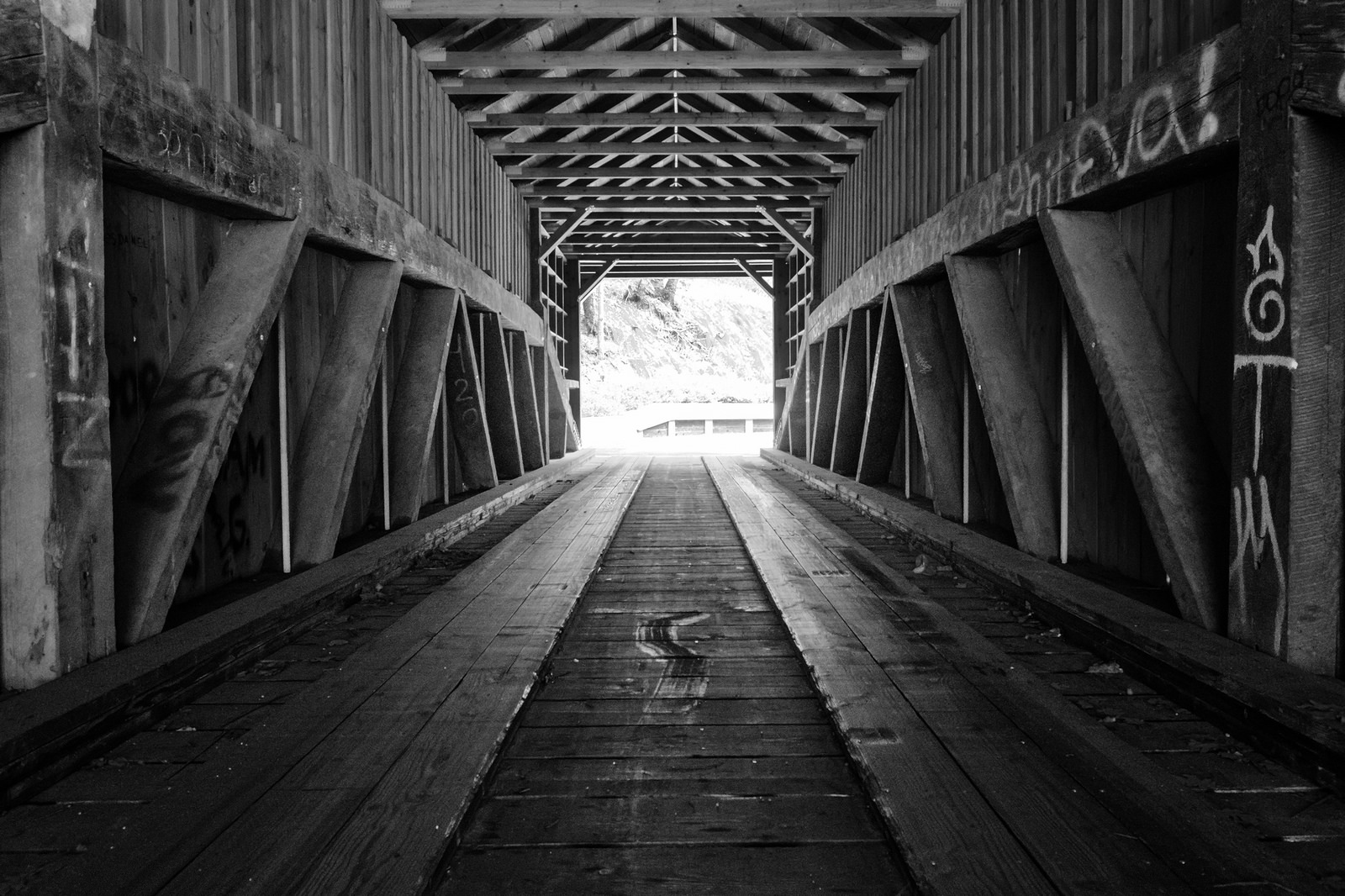 The rebuilt bridge uses some of the same wood that was used in the original bridge.