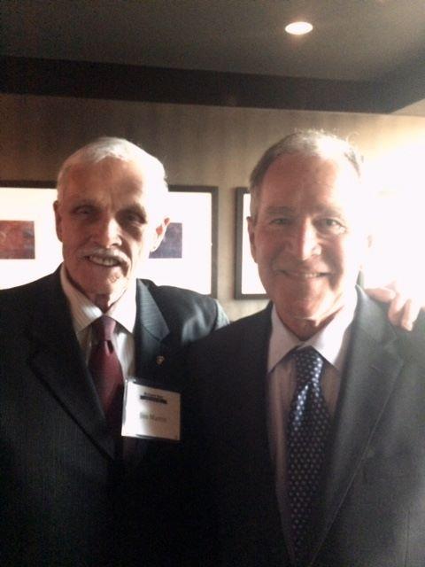 Source  James Martin (left) with former President Bush