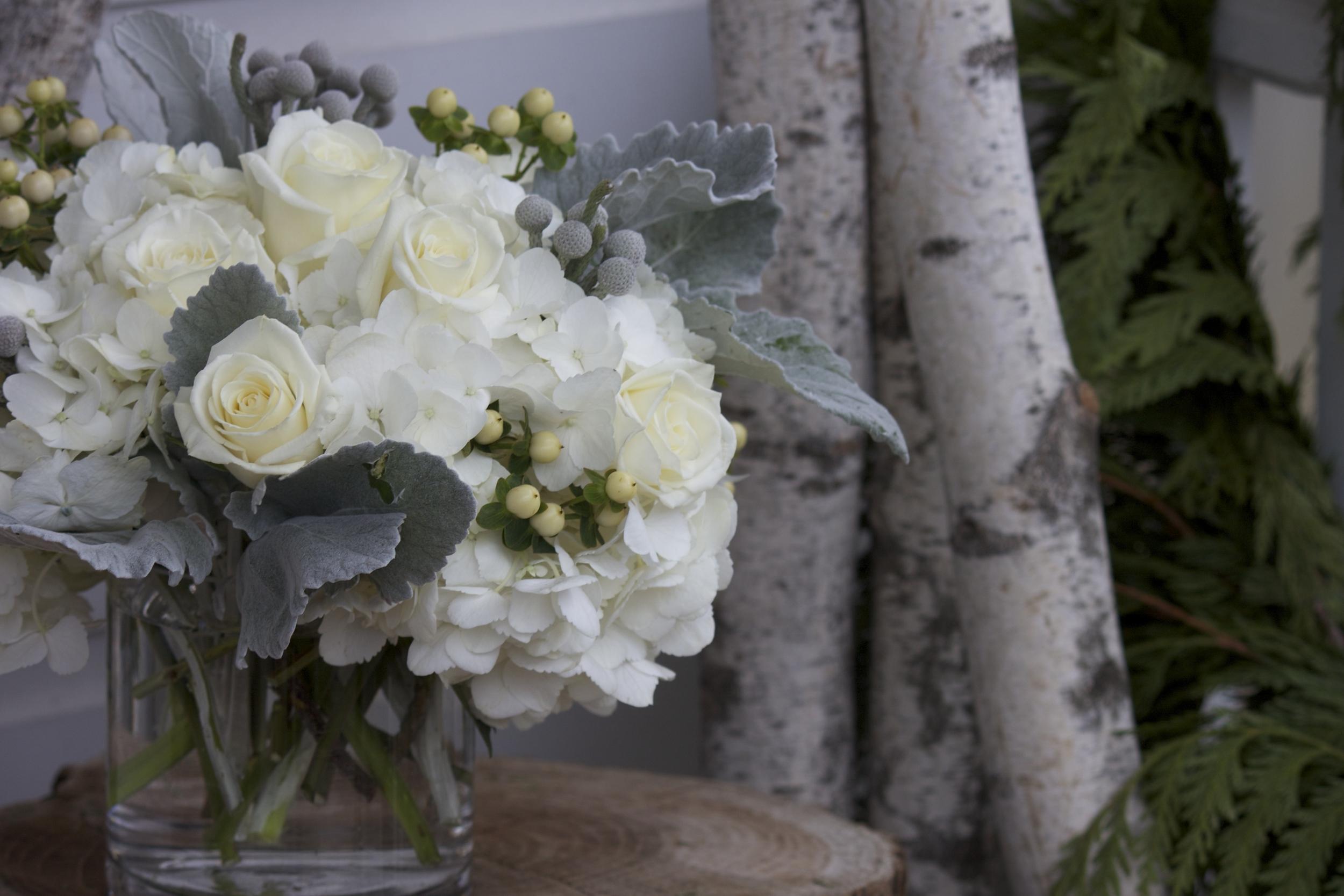 Brunia berries (gray), white Hypericum berries, white hydrangea, Dusty Miller (gray leaves), white roses