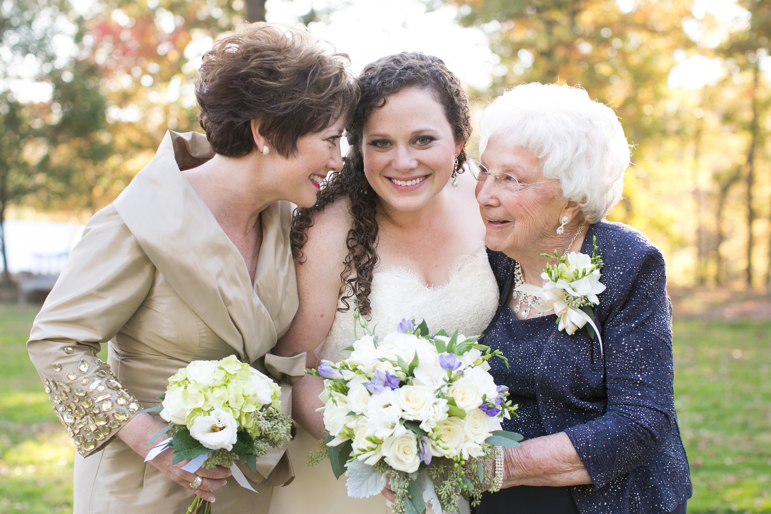 Love this shot of mom, bride and grandmother, each with their own floral accessory.  The bride's bouquet has just a touch of soft purple with sage greens and gray accents to bring in a bit of the season.