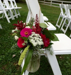 Summer bloom arrangements on outdoor chairs can be moved inside.