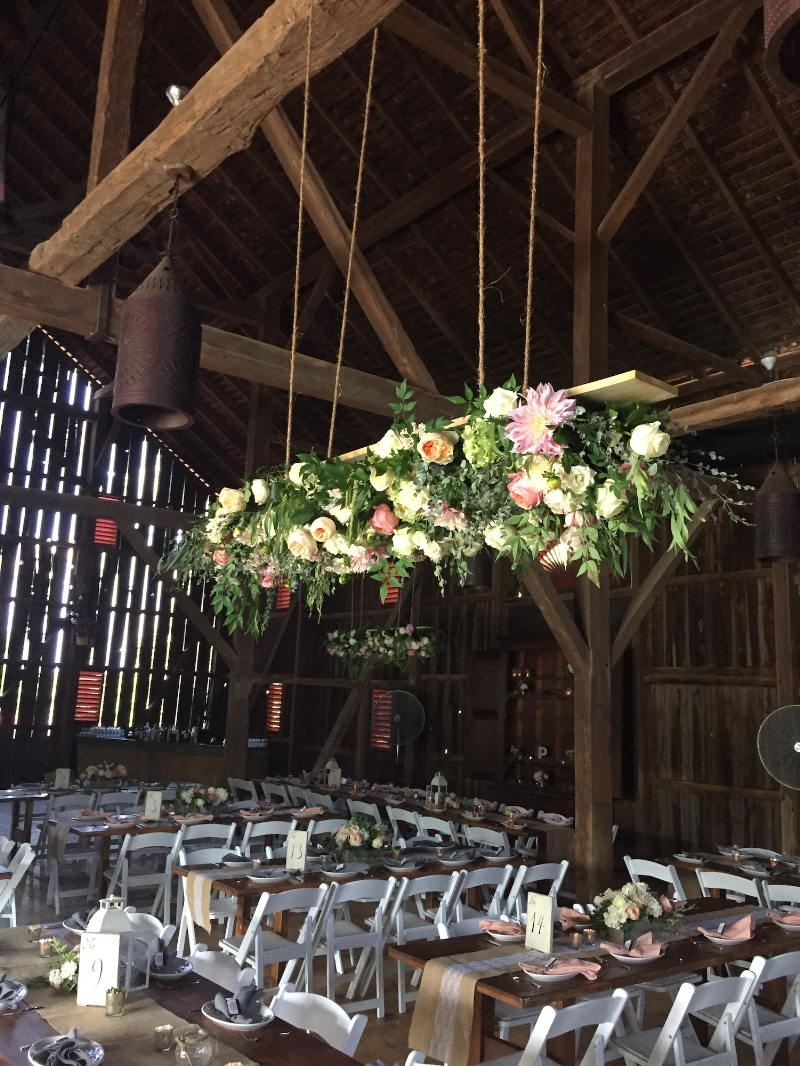 The barn at the Riverside on the Potomac offers exciting opportunities to raise the visibility of your wedding flowers