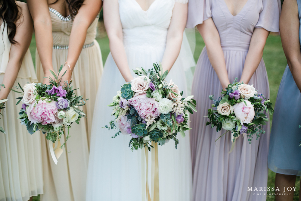 Trailing Ivory ribbons complement the gowns. Photo: Marissa Joy Photography