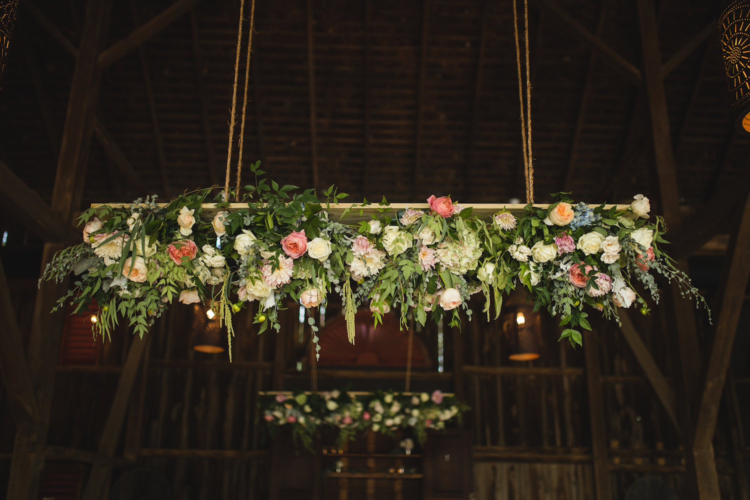 Hanging Chandelier suits the vaulted barn ceiling at Riverside On The Potomac. Photography by Carly Romeo.